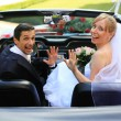 Royalty-Free Stock Photo: Young wedding couple in cabriolet car