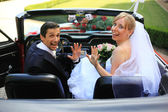 Young wedding couple in cabriolet car — Stock Photo