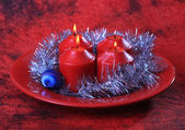 Four candles and christmas decorations — Stock Photo