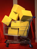 Shopping cart with boxes — Stock Photo