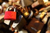 Bunch of padlocks with love lock — Stock Photo