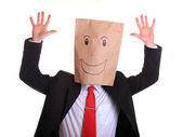 Happy businessman with a paper bag with smile on head — Stock Photo