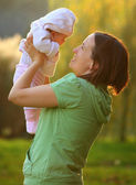 Young woman with her baby outdoor — Stock Photo
