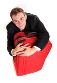 Business man hug luggage — Stock Photo