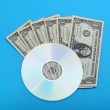 DVD disc with dollar notes — Stock Photo #42215647