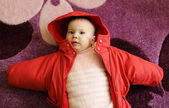 Young baby in coat — Stock Photo