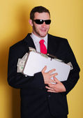 Business man hold suitcase with full of money notes — Stockfoto
