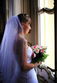 Bride near the window — Stock Photo
