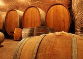 Wine barrels in wine cellar — Stock Photo