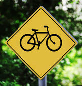 Yellow traffic label with bicycle pictogram — Stock Photo