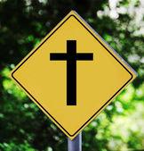 Gele verkeer label met kruisbeeld pictogram — Stockfoto