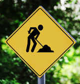 Yellow label with working man pictogram — Stock Photo