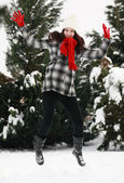 Woman jumping in winter — Stock Photo