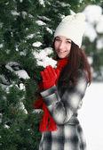 Woman behind pine — Stock Photo