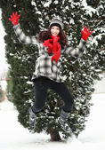 Young beauitiful woman outdoor in winter jumping — Stock Photo