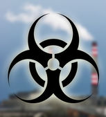 Industrial building with biohazard symbol — Stock Photo