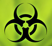 Biohazard symbol against green background — Stock Photo