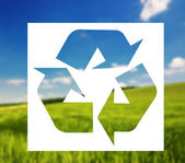 Recycling sign against landscape background — Stock Photo
