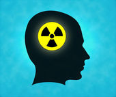 Profile of silhouette with radioactive symbol — Stock Photo