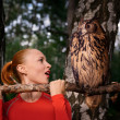 Red woman with big owl — Stock Photo