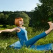 Red woman practicing fitness yoga outdoors — Stock Photo #15621693