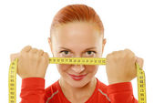 Young red woman with measuring tabe — Stock Photo