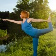 Yoga practice. Red woman practicing fitness yoga — Stock Photo