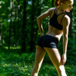 Sensuous fitness woman in park — Stock Photo