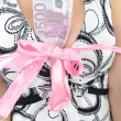 Постер, плакат: Euro banknote in woman breast