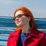 Red woman enjoying sunny day — Stock Photo