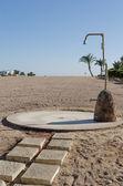 Beach shower at the tourist resort — Stock Photo