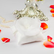 Beautiful pillow for wedding rings with rose petals - Stock Photo