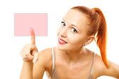 Young woman pressing virtual button — Stock Photo