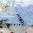 Cracked and broken glass window — Foto Stock