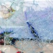Cracked and broken glass window — Stock Photo