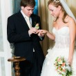 Young wedding couple putting the ring — Stock Photo