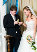 Young wedding couple putting the ring — Стоковое фото