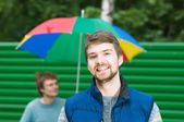 Portrait of happy young men, looking at camera, smiling — Stock Photo