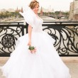 Bride on a bridge — Stock Photo