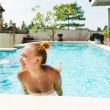 Happy woman in pool — Stock Photo