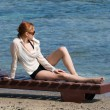 Young red woman sunbathing — Stock Photo