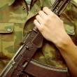 Soldier with AK-47 assault rifle — Stock Photo