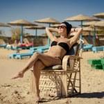 Young woman enjoying sun at the beach — Stock Photo #35841423
