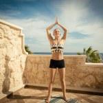 Beautiful woman practicing yoga — Stock Photo #37912849