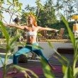 Woman doing yoga in the morning — Stock Photo #41346687