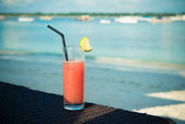 Fruit cocktail on the beach — Stock Photo