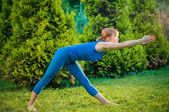 Beautiful woman practicing fitness or yoga — Stock Photo