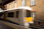 Train entering a station, with motion blur — Stock Photo