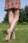 Womans legs over white — Stock Photo
