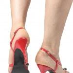 Frau setzen auf high heels Schuhe über grauen Hintergrund — Stockfoto #32674507